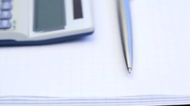 Calculator, pen and notepad turning — Stock Video