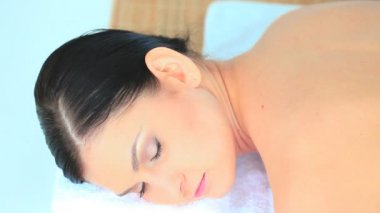 Dark-haired woman relaxing while having a massage — Stock Video