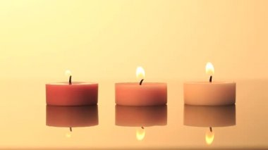 Lighted candles on a yellow background — Stock Video