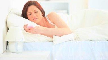Brunette awoken by her mobile — Stock Video