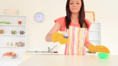 Attractive woman cleaning the kitchen — Stock Video