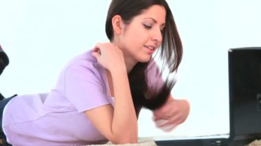 Young woman using her laptop and laughing — Stock Video