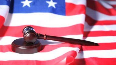 Gavel raised on an American flag — Stock Video