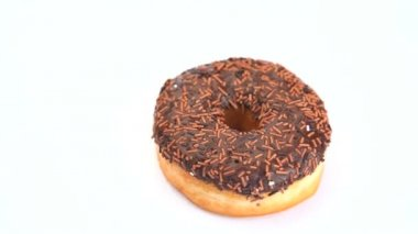 Donut with chocolate icing rotating — Stock Video