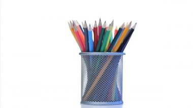 Color pencils rotating in a pencil holder — Stock Video