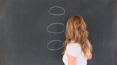 Cute blond-haired teacher drawing a scheme — Stock Video