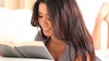 Cute brunette reading a book — Stock Video