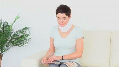 Injured brunette waiting for her appointment — Vídeo de Stock