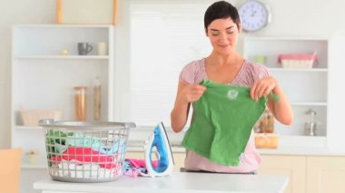 Smiling housewife ironing clothes — Stock Video
