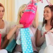Happy women checking their shopping bags — Stock Video