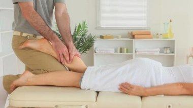 Masseur massaging a cute woman's leg — Stock Video
