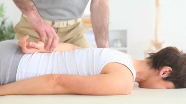 Chiropractor stretching the arm of a woman — Stock Video