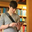 Male student working with a tablet — Stockvideo