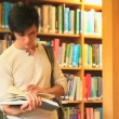 Stockvideo: Handsome mreading book