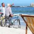 Couple with bikes exploring a beach — Stock Video #20306709
