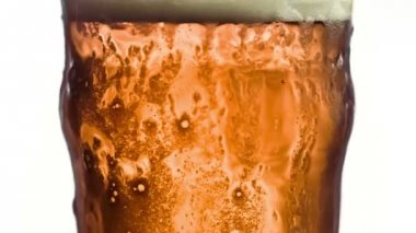 Overflowing glass of beer in super slow motion — Stock Video