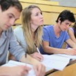 Serious students taking notes — Stockvideo #20393513