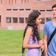Stock video: Good looking students flirting