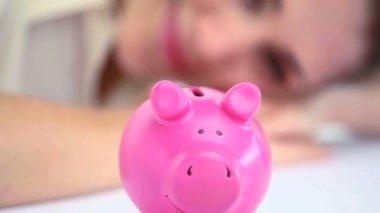 Woman looking a piggy bank — Stock Video