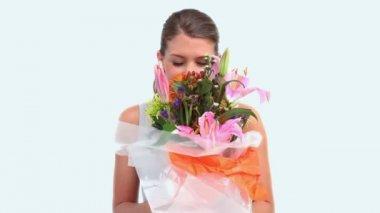 Woman smelling a flower bouquet — Stock Video