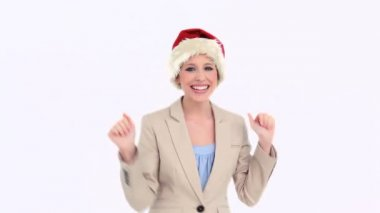 Businesswoman dancing while wearing a Santa Claus hat — Stock Video
