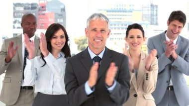 Happy businessman applauding while standing — Stock Video