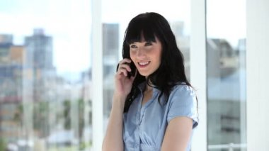 Cheerful businesswoman talking on the phone — Stock Video