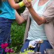 Mother and daughter wearing garden gloves — Vídeo Stock