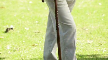 Peaceful man standing while using a cane — Stock Video