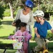 Smiling mother fastening helmets of her children — Stok Video #20870879