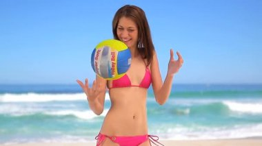 Happy brunette woman playing with a beach ball — Stock Video