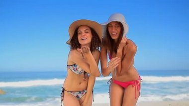 Happy brunette women blowing air kisses — Stock Video