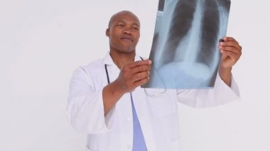Happy practitioner holding a chest x-ray — Stock Video