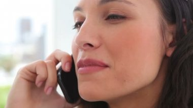 Businesswoman smiling as she talks on a phone — Stock Video