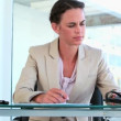 Businesswoman working at her office — Stock Video