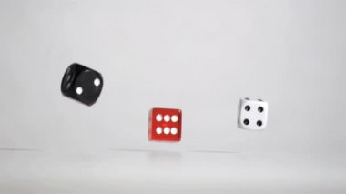 Three black red white dices in a super slow motion rebonding — Stock Video