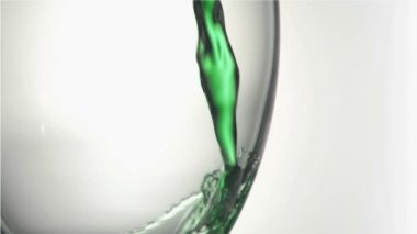 Close up, green trickle in a super slow motion splashing in a glass — Stock Video