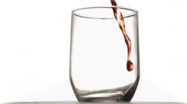 Red thin trickle in a super slow motion falling in a glass — Stock Video