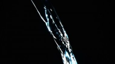 Close up, trickle of water in a super slow motion flowing with blue glint — Stock Video