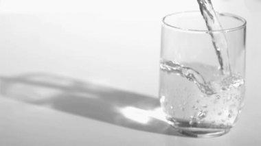 Water flowing in super slow motion into a glass — Stock Video