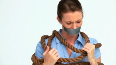 Businesswoman attached with a rope and having tape on her mouth — Stock Video