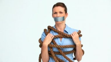 Woman with tape on the mouth and attached with a rope — Stock Video