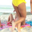 Three women sitting down on their towels — Stock Video