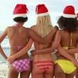 Four girls embracing each other while wearing santa hats — Video
