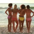 A group of girls sand together and look at the water — Stock Video