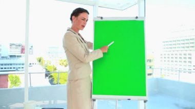 Woman in suit giving a presentation with a board — Stock Video