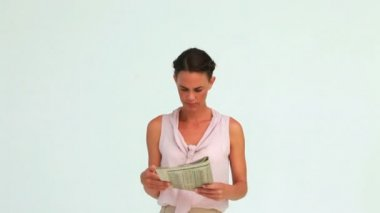 Businesswoman reading the news posing with a smile — Stock Video