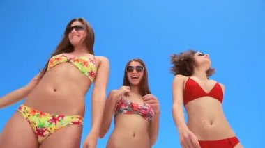 Three girls dancing together in bikinis — Stock Video