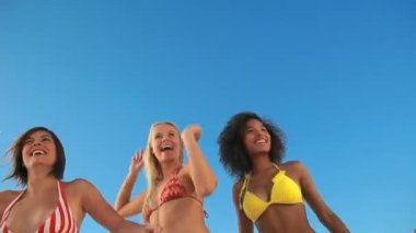 Women jumping while raising their arms — Vídeo stock