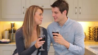 Couple sitting in the kitchen drinking wine — Stock Video